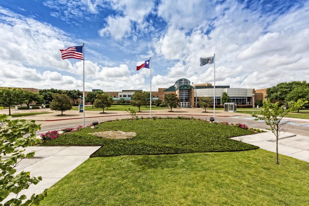 Southeast campus roundabout with flags.